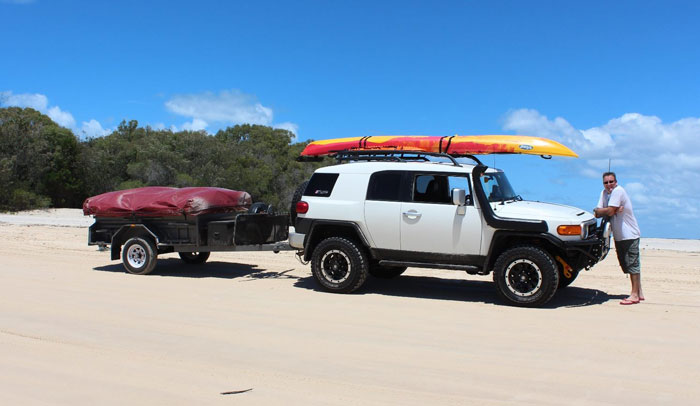 Brett with the FJ Cruiser and their old camper trailer on Fraser Island